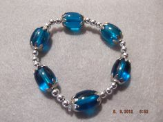 Blue with Silver beads $15.00 if delivery locally if shipped please add 3.95
