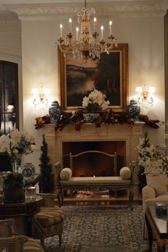 The Enchanted Home-Christmas 2015. Lovely mantelpiece--blue and white ginger jars and magnolia…elegant simply perfect