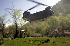 A CH-47 Chinook helicopter carries U.S. Army Soldiers from 1st Battalion, 32nd Infantry Regiment during an air assault operation in Paroons, Afghanistan, May 3, 2007