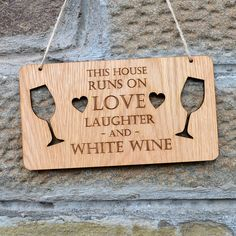 Pretty Personalised This House Runs on Love Laughter and Wine – LARGE Personalised Oak Wooden Sign ll Professionally engraved onto beautiful, real oak veneered wood with rustic thick twine rope. This quality sign can be completely personalised if you would rather the plaque said something different! The perfect housewarming gift or new home present for your house. http://prettypersonalised.co.uk/ #gifts #giftshop #handmadegifts #newhome #housewarming #whitewine #redwine