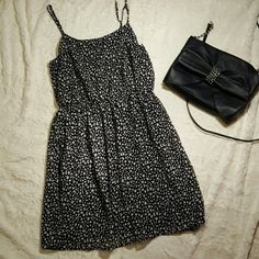 Leopard print chiffon dress Only worn a few times, excellent condition. Black & white leopard print chiffon dress with black lining. Adjustable straps & elastic waist.  Brand: forever 21 Size: small Forever 21 Dresses Midi