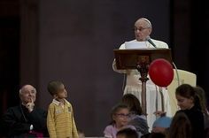 A little boy wandered onto stage to hang out with Pope Francis and refuses to leave (story told in photos)