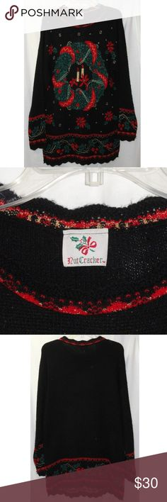 VTG CHRISTMAS Sweater LUREX NUTCRACKER Wreath Women's Christmas Pullover style Sweater size Medium by NUTCRACKER.  black, a sparkly green & red Christmas Wreath with 2 candles in the center with Poinsettias and stars wide band of Holly and berries along the bottom edge and the long sleeves. This item is in very good USED condition.  I did not find any tears or stains.  This sweater is made of 80% acrylic, 20% lurex and may be machine washed. Approx Measurements: Chest:  42 in Length:  32 in…
