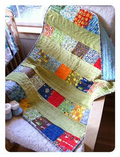 EASY baby quilt. requires one charm pack, plus fabric for sashing. Cheap. tutorial included in the post.