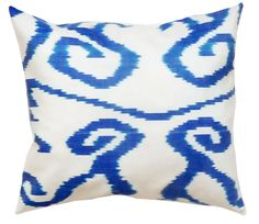 These light, airy blue and white Ikat pillows will brighten up your bed. Pair with solid blue or silver gray pillows.