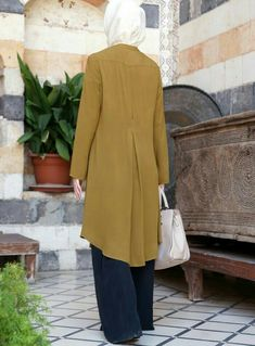 Pair casual tunics with your favorite denim and wear our professional blouses to the office. Pakistani Fashion Casual, Pakistani Dress Design, Hijab Fashion, Fashion Outfits, Muslim Women Fashion, Islamic Fashion, Stylish Dresses, Casual Dresses, Dresses For Work