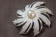 Swirled Silvertone and Pearl Brooch