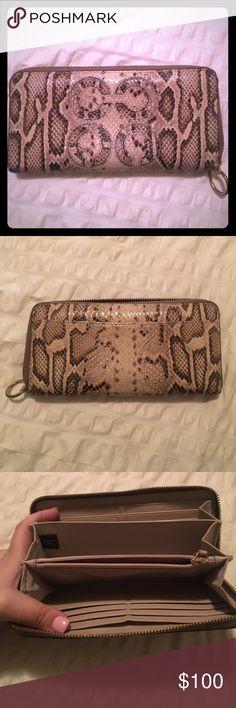 Coach zip around wallet, snakeskin pattern Coach snakeskin print zip around wallet. In great condition! Gold zipper. Coach Bags Wallets