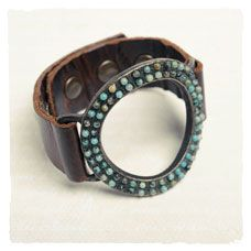 Hand set jasper beads embellish a ring of antique brass finished metal buckled to vintage, Italian leather