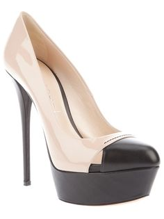 Nude pump from Casadei featuring a pointed black leather toe, with two side cut-outs, a large black platform, a leather sole, a black stiletto heel and a nude leather upper.