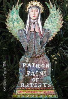 Saint Catherine (angel ornament) Angel ornament: This is a folk art mixed media art collage assemblage. St. Catherine of Bologna, patron saint of artists. Embossed wings(translucent embossing over rubber stamped collage, ice enamel edges), layers of ripped collage papers painted over, gilders paste on angel edges, rubber stamps, liquid dots (viva decor), ranger distressing, beads, paint, paper, cut and paste on masonite base.