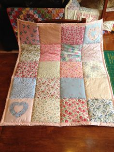 floral baby quilt. Handmade gorgeous 30x35 patchwork baby or home quilts . Made from all new materials with cotton/ poly cotton outer & warm comfy lightweight wadding its machine washable on 30 degrees & can be tumbled on a gentle heat. This is a bespoke item lovingly made with a stunning selection of ditsy floral prints..., two appliqued hearts just for fun...each & every quilt i make is different. It would a make wonderful gift for a new baby, an heirloom to treasure. It wo...