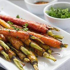 Looking for a quick side dish that doesn't cost more than $2? Carrots are one of the cheapest veggies available in the grocery store! Roasting them until golden with a caramelly brown-sugar glaze turns them from cheap to chic. Serve this side dish with any steak or chicken dish.