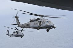 Two Pave Hawks from the Rescue Squadron at Moody Air Force Base, Ga., fly in formation in preparation for an air-to-air refueling with an Combat Shadow over Hurlburt Field, Fla., May The final two in the Air Force landed for the last time at Military Helicopter, Military Guns, Military Photos, Military Aircraft, Military Vehicles, Hd Widescreen Wallpapers, Panama City Panama, Armed Forces, Air Force