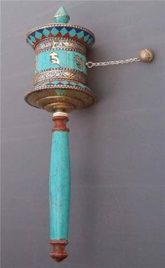 ritual--Tibetan prayer wheel spinning for blessings and prayers