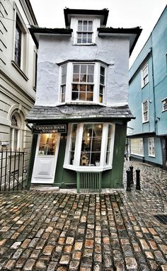 The Crooked House of Windsor (also known as the Market Cross House) in Windsor, England, is a building constructed in 1592, now a restaurant. The building now stands at a marked angle, having been rebuilt with green wood in 1718.  There is a secret passage in the basement, supposedly used for illicit trysts between Nell Gwynn and Charles II and/or delivering produce from the market to the kitchens of Windsor Castle.