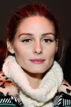 Who: Olivia Palermo What: Winged Liner & Berry Lipstick How-To: The style star arrived at Diane von Furstenberg's fall show looking effortlessly flawless—no easy feat on the coldest day of the year. She ditched her go-to winter hairstyle—the tuck-in—in favor of an easy bun and let her precision eyeliner skills and raspberry lip color be the focus. Editor's Pick: Chantecaille Hydra Chic Lipstick in Aster, $36, chantecaille.com.   - HarpersBAZAAR.com