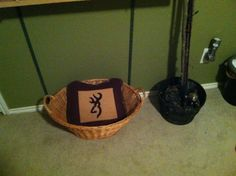 Homemade Browning pillow/blanket in a wicker basket. Planning to add some more camo blankets. #hunting #little boys room