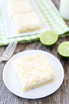 Coconut Lime Sugar Cookie Bars Recipe on twopeasandtheirpod.com Easy coconut lime sugar cookie bars with coconut frosting!