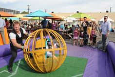 A human bowling activity—in which guests tried to knock over oversize pins from within a caged ball—was among the crowd favorites at the Elizabeth Glaser Pediatric AIDS Foundation's A Time for Heroes family festival.