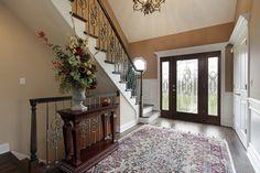 Decorative glass front door at luxury foyer Wooden Double Doors, Light Hardwood Floors, Dark Hardwood, Foyer Furniture, Entrance Foyer, Entrance Hall, Entryway Decor, Beige Marble, Foyer Design
