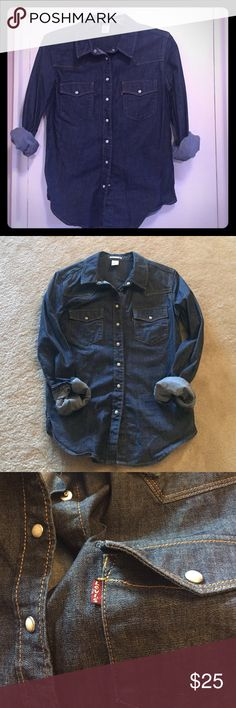 Women's Levi's Denim shirt. Women's Levi's Denim Blouse in a heavy weight Denim. Traditional Western styling with pearl snaps. Fitted styling. In very good pre-loved condition. No visible flaws. Levi's Tops Button Down Shirts
