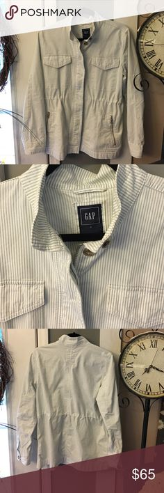 NWOT, Gap Light Blue & White Striped Jacket New without tags, never got to wear. Zip up and button up front. pockets on front have zippers, pic of materials in photos, light blue and white women's jacket.  Two top pockets button . No low ball offers please. GAP Jackets & Coats