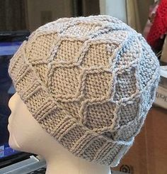 Ravelry: Wavy Diamond Hat with  Pom Pom pattern by Sarah Luse 14 stitches and 20 rows = 4 inches in K2 P2 Rib Needle size US 8 - 5.0 mm US 9 - 5.5 mm 110 - 128 yards (101 - 117 m) Sizes available One size fits most