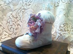 Adornments by Lisa...Lisa is a GENIUS!!!  Look at these adorable baby booties...so easy and so adorable as a pincushion!!  (Hey...if you are one of my friends...LOOK AWAY, LOOK AWAY!!)