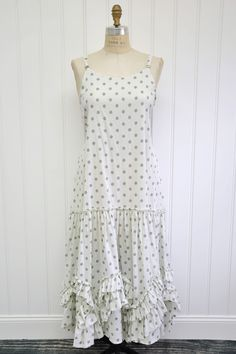 """Features:    Lovely long slip   Full hem   Raw edge ruffled detail along bottom   Skinny straps   Side ties   100%polka dot cotton lawn, cream/dark oat   Fits sizes 2-14   Measurements:    Chest: about 40"""" around   Length: about 53"""" long"""
