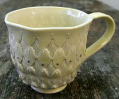 Pale Yellow Celadon on English Porcelain.  Stamps made by me, underglaze and slip trailing.  Mark Strayer, North Star Pottery