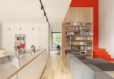 In the city's Villeray neighborhood, a cramped structure is recast as an open work-play space for a young family.