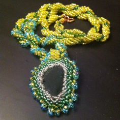 Green sea-glass necklace. Glass collected in Brean, jewellery made in Essex. Made by Charlotte Clark, Roxwell Beads.