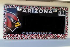 Cardinals colors!!  Bling license plate frame. Red, clear and black multi-sized rhinestones on a chrome frame.