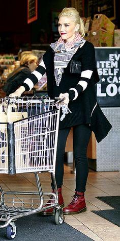 Scarf, patterned top, black skinnies/leggings, boots.