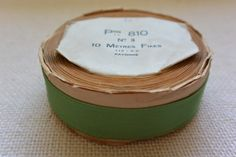 Lime Green Vintage Grosgrain Ribbon 3/4″ wide 8 yards long on original paper roll A roll of vintage French grosgrain ribbon in a lime green color. The ribbon is wound in its original packaging. The width on the label is: No. 3 The spool reads the following: Pon 810; No. 3; 10 Me'tres Fixes; Rayonne […]