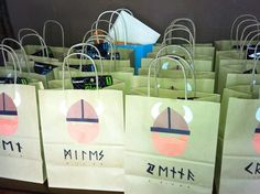 Goody bags at a Viking birthday party....kids' names written runic-ally in Old Norse!