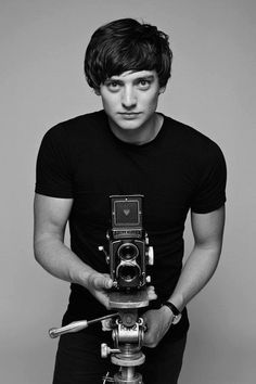 I like this image because it is a high key background image. I like the fact he has a film camera in the picture to show that he might be going to shoot a film. It is by David Bailey which is a famous photography. The light is a soft light that is hitting him.