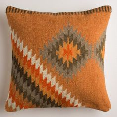 Crafted in India of 100% wool with a removable insert, our warm and cozy pillow features a bold Southwestern design on a sunset-colored field.