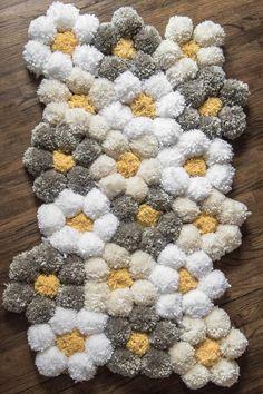 How to Make a Pom Pom Rug the Easy Way - It's SO Fluffy! A tips and tricks tutorial for making a pom pom rug really fast! We give details about what pom pom rug backi Diy Pom Pom Rug, Pom Pom Crafts, Yarn Crafts, Yarn Pom Poms, Fabric Pom Poms, Pom Pom Wreath, Diy Tapis, Bernat Softee Chunky Yarn, Clover Pom Pom Maker