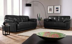 If I had to go for black leather, it would have to be something like this...   Sienna Black Leather Sofa