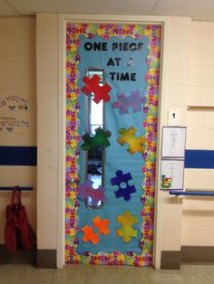 My classroom door for autism awareness month.  I put my students pictures on the puzzle pieces.