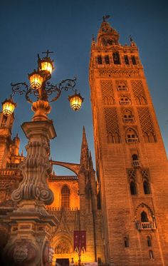 Travel Inspiration for Spain - La Giralda: The tower of the Seville cathedral. It is an admirable example of Moorish architecture. Places To Travel, Places To See, Places In Spain, Seville Spain, Andalusia Spain, Spain And Portugal, Places Of Interest, Monuments, Spain Travel
