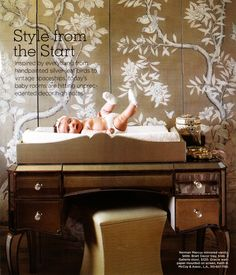 may end up using a spare dark wood desk as a changing table if we can't find the right dresser first - hamper below?