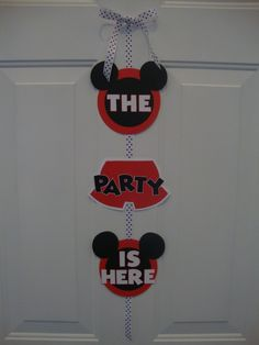 "Mickey Mouse ""The Party is Here"" Door Sign. $15.00, via Etsy."