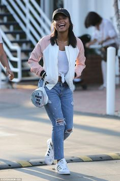 Having a laugh: On Friday Christina kept it casual in the same neighborhood, rocking a cool and casual sportswear look complete with cheeky slogan handbag