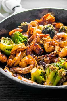 Honey Garlic Shrimp and Broccoli! Browned honey garlic shrimp with tender broccoli - a super easy dinner that packs a wallop of flavor with simple, common ingredients. | HomemadeHooplah.com