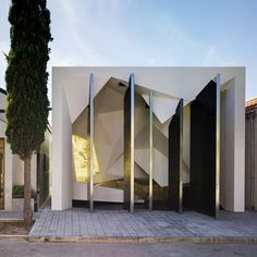 The zig-zagging doors of this mausoleum in Murcia by Spanish studio Clavel Arquitectos can only be opened in one specific order.