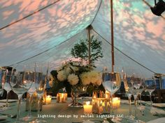 Abstract foliage gobos in a mix of pastels illuminate a sailcloth wedding tent. Wedding Tent Lighting, Tent Wedding, Sailing Outfit, Lighting Design, Table Decorations, Sperry, Abstract, Tents, Pastels