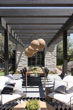 A Newport Beach Farmhouse Exudes California Cool - Luxe Interiors + Design Indoor Outdoor Living, Outdoor Dining, Outdoor Spaces, Outdoor Decor, Outdoor Lighting, Dining Table, Estilo Tudor, Farmhouse Style, Farmhouse Decor